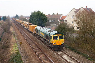 66617 leads the HOBC past St. Georges as the 6Y11 09.00 Abbotswood Junction to Taunton Fairwater Yard, 66616 is dead on the rear. Hope that hot plate isn't on! Sunday 3rd March 2013.