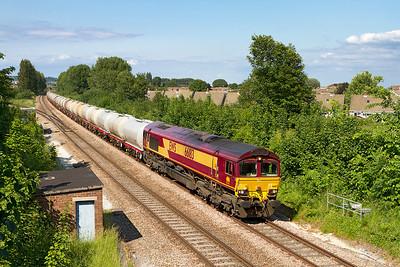 66183 passes Uphill Junction with 6C62 15.31 St. Phillips Marsh to Tavistock Junction fuel tanks. Tuesday 25th June 2013.