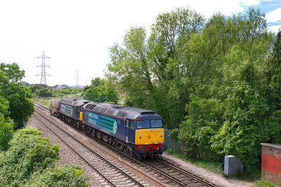 57011 & 57003 pass Worle Junction heading 6M63 14.02 Bridgwater to Crewe Coal Sidings with Flask Carrier FNA 550040. Monday 17th June 2013.