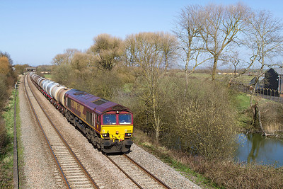 66040 heads 6C62 15.31 St. Philips Marsh to Tavistock Junction (Ex Fawley) fuel tanks past Hutton Moor on the Weston-super-Mare avoiding line. Tuesday 16th April 2013.