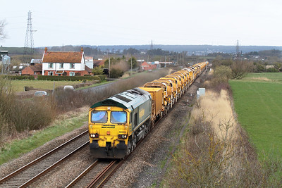 66604 & 66603 top & tail the HOBC past Accommodation Road, Lympsham running as 6Y11 08.51 Abbotswood Junction to Taunton Fairwater Yard. Sunday 14th April 2013.