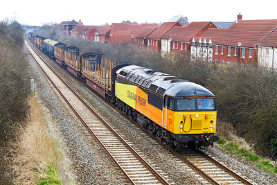 56105 heads along the Weston-super-Mare avoiding line at Locking Castle with 6Z52 07.13 Chirk kronospan to Teigngrace empty log carriers. Wednesday 10th April 2013.