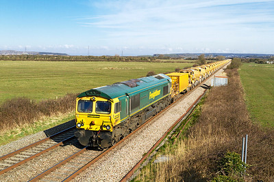 66619 'Derek W. Johnson MBE' and 66607 top and tail the HOBC past Brean Road, Lympsham running as 6Y11 08.30 Abbotswood Junction to Taunton Fairwater Yard. Sunday 31st March 2013.