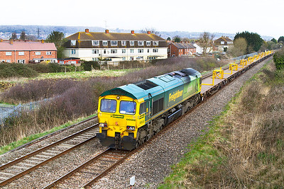 66522 leads an empty set of YKA wagons past Oldmixon on the Weston-super-Mare avoiding line running as 6Y84 09.27 Westbury to Cogload Junction (entry to the possession site). Tuesday 16th April 2010.