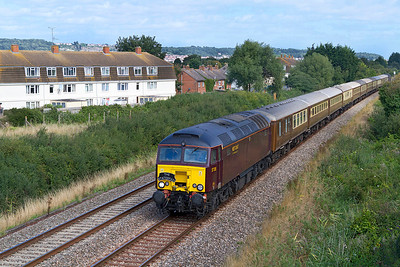 Running some 35 minutes late, recently repainted 57315 heads 'The English Riviera Statesman' 1Z47 06.15 Crewe to Kingswear in connection with the Dartmouth Royal Regatta along the Weston-super-Mare avoiding line at Oldmixon. 47786 is dead on the rear. Saturday 31st August 2013.