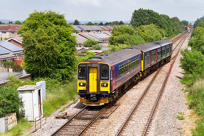 153377 & 150131 cross over at Worle Junction forming the 2C77 13.00 Cardiff Central to Exeter St. Davids. Monday 17th June 2013.