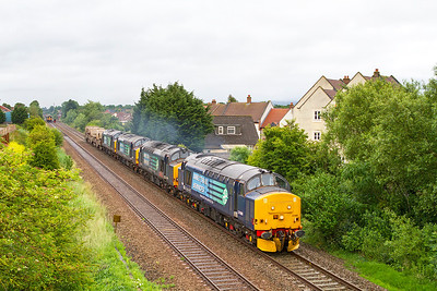 With 37605 & 37609 having failed at the start of their journey with power issues, 37688 'Kingmoor TMD' & 37610 'T.S. (Ted) Cassaday 14.5.61 - 6.4.08' power 6V74 01.58 Crewe Coal Sidings to Bridgwater Yard with FNA's 550028, 550056 & 550054 running some 85 minutes late pass St. Georges. Thursday 4th July 2013.