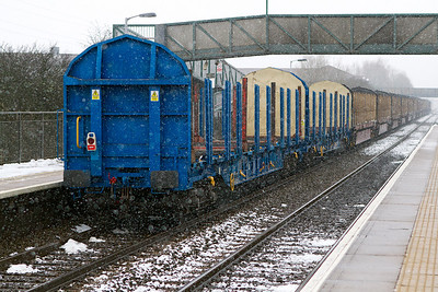 A pair of the new blue liveried wagons bring up the rear of 6Z52 passing Worle Parkway. Wednesday 23rd January 2013.
