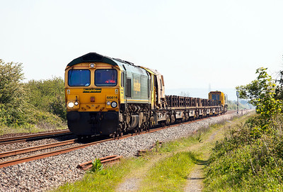 66614 top & tailed with 66602 pass Hewish Level Crossing with 6Y27 08.45 Moreton Cutting, Didcot to Hackney Yard welded rail carriers. Sunday 18th May 2014.