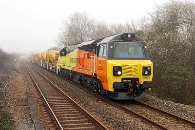 The first Class 70 to pass Worle was Colas Rail's 70805 heading 6Z47 09.29 Cardiff Canton Sidings to Taunton Fairwater Yard with refurbished HOBC wagons. Friday 14th March 2014.