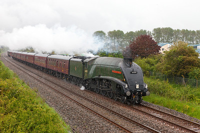 60009 'Union of South Africa' heads through the rain on the Weston-super-Mare avoiding line approaching Uphill Junction with 1Z34 08.57 Kidderminster to Bishops Lydeard. Saturday 24th May 2014.