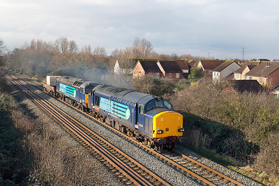 37610 'T.S. (Ted) Cassady 14.5.61-6.4.08' with 57003 DIT & FNA 550029 opens up after a signal check on the Weston-super-Mare avoiding line, running as 6M63 11.58 Bridgwater to Crewe Coal Sidings. Wednesday 29th January 2014.