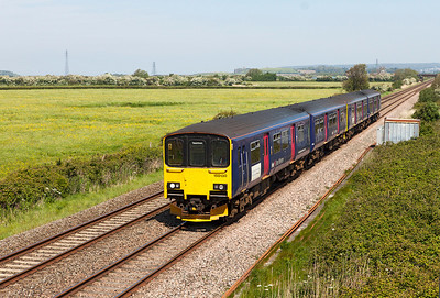 150130 & 150129 pair up to form 2T33 10.07 Cheltenham Spa to Taunton passing Brean Road, Lympsham. Sunday 18th May 2014.