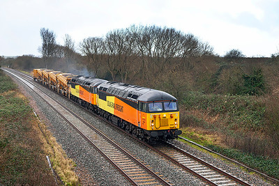 56094 & 56302 head through the rain on the Weston-super-Mare avoiding line at Hutton Moor with 6Z56 11.27 Taunton Fairwater Yard to Cardiff Canton Sidings formed of YDA's DR92323/24/26 & 25 & YSA DR92702. Monday 6th January 2014.