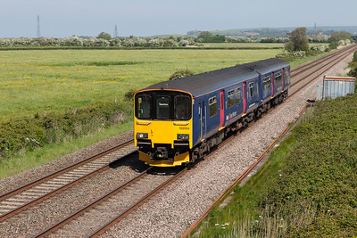 150104 passes Brean Road, Lympsham forming 2C71 09.46 Severn Beach to Taunton. Sunday 18th May 2014.