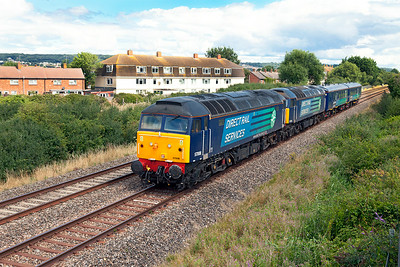 57008 & 57009 pass Oldmixon on the Weston-super-Mare avoiding line with Escort Coaches 9419 & 9248 running as 5Z52 07.10 Crewe Gresty Bridge to Keyham, Plymouth. Monday 28th July 2014.