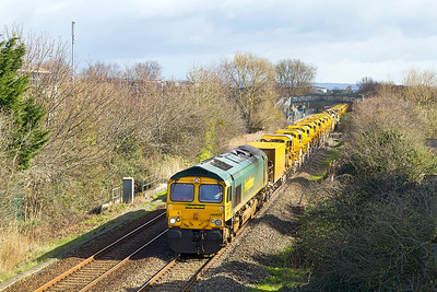 66617 leads the HOBC past Worle Parkway running as 6Y11 08.00 Standish Junction to Taunton Fairwater Yard. 66953 is the rear locomotive out of sight. Sunday 23rd March 2014.