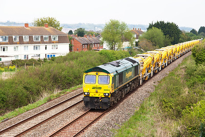 66953 passes Oldmixon on the Weston-super-Mare avoiding line with 6C73 Westbury to Taunton Fairwater Yard. Monday 28th April 2014.
