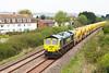 66953 passes Oldmixon on the Weston-super-Mare avoiding line with 6C73 Westbury to Taunton Fairwater Yard. Monday 28th April 2014.