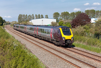 The 1V56 07.50 Glasgow to Plymouth formed of 221140 passes Oldmixon on the Weston-super-Mare avoiding line. Thursday 15th May 2014.