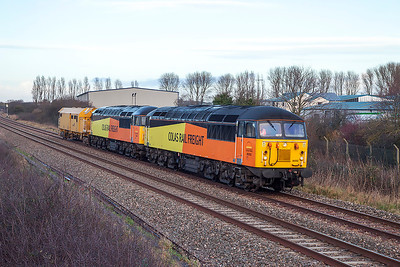 56302 & 56094 with DR 78831 pass Oldmixon on the Weston-super-Mare avoiding line as 6Z47 09.59 Burton Wetmore Sidings to Taunton Fairwater Yard. The loco's returned a shortwhile later light engine to Cardiff Canton. Thursday 2nd January 2014.