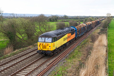Running an hour late, 56302 passes Wick Road, Hewish with 6V51 12.31 Exeter Riverside Yard to Chirk Kronospan loaded log carriers. Thursday 20th March 2014.