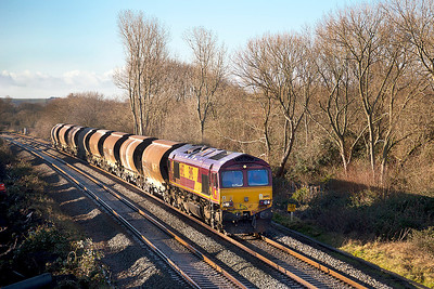Running 2 hours early 66192 passes Hutton Moor on the Weston-super-Mare avoiding line with 6M60 07.06 St.Blazey to Bescot Yard via Newport ADJ Yard. Saturday 11th January 2014.