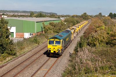 66549 passes Winterstoke Road on the Weston-super-Mare avoiding line with 6C73 12.12 Westbury Up Yard to Taunton Fairwater Yard via Bristol ballast working. Monday 28th September 2015.