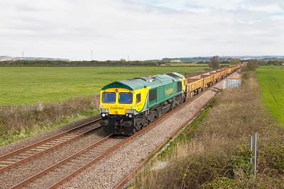 66414 passes Brean Road Lympsham with 6Y20 07.00 Bridgend to Taunton Fairwater Yard empty ballast boxes. Sunday 19th April 2015.
