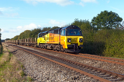 70807 top & tailed with 70809 passes Mud Lane, Claverham with 6C97 08.20 Crediton to Westbury Up Yard via Bristol welded rail train. Sunday 9th October 2016.