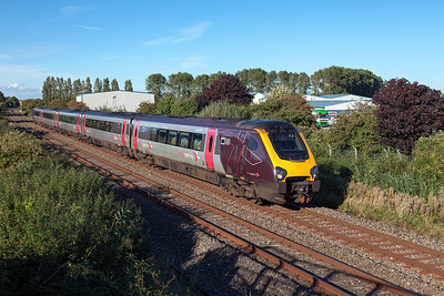 221131 passes Oldmixon on the Weston-super-Mare avoiding line forming 1V60 08:20 Aberdeen to Penzance. Friday 26th August 2016.