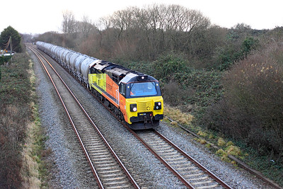 In the last of the afternoon light, 70805 heads along the Weston-super-Mare avoiding line with 6C36 10.03 Moorswater to Aberthaw Lafarge Cement Works empty PCA's. This is the second working of this new flow. Thursday 8th December 2016.