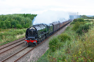 "46233 'Duchess of Sutherland' passes Middle Street, Brent Knoll with ""The Royal Duchy"" from Bristol to Par. Sunday 28th August 2016."