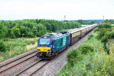 68017 'Hornet' passes Middle Street, Brent Knoll with 1Z58 06.02 Swansea to Par Belmond Northern Belle excursion. 68008 'Avenger' is DOR. Saturday 30th July 2016.