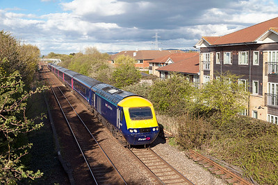 Power Car 43002 is due to be painted into original colours to celebrate 40 years of the HST at the St. Phillips Marsh open day on Monday 2nd May. The transformation has started with the cab roof being painted yellow and the rest of the roof painted black. Seen departing from Worle Parkway heading 1C20 15.20 Paddington to Weston-super-Mare. 43165 'Prince Michael of Kent' is the rear power car. Monday 25th April 2016.