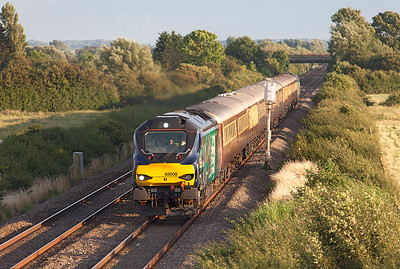 In the last of the evening light 68008 'Avenger' passes Middle Street, Brent Knoll with the returning 1Z59 16.30 St Austell to Swansea Belmond Northern Belle excursion. 68017 'Hornet' is DOR. Saturday 30th July 2016.
