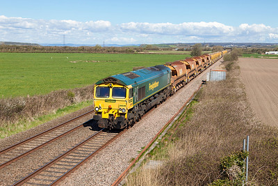 66548 Top & Tailed with 66546 with 5 HQA's and the MOBC pass Brean Road, Lympsham running as 6Y19 07.00 Landore Junction to Fairwater Yard. Sunday 17th April 2016.