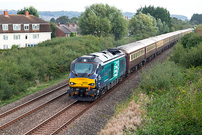 68001 'Evolution' passes Oldmixon on the Weston-super-Mare avoiding line with 1Z53 05.40 Birmingham International to Penzance Belmond Northern Belle charter. 68002 'Resolution' is DOR. Saturday 3rd September 2016.
