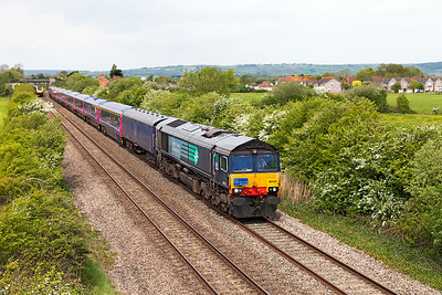 66425 passes Crooked Lane, Brent Knoll with 5V47 09.55 Derby to Laira Depot with refurbished HST coaches 41018, 40811, 40106, 42025, 42362, 42025, 42362, 42024, 42046 & 44008 and barrier coaches 6338 & 6330. Sunday 15th May 2016. The consist left Kilmarnock the day before behind 47830 which failed near Carlisle and was replaced by 66425.