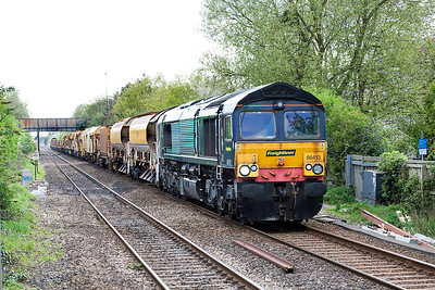 66413 & 66536 top & tail the Track Replacement Train past Worle Parkway running as 6X04 16.50 Fairwater Yard to Bridgend. Monday 17th April 2017.