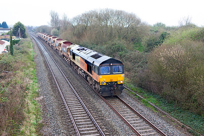 66847 passes Hutton Moor on the Weston-super-Mare avoiding line with 6C26 06.38 Plymouth to Westbury empty ballast wagons. Running via Bristol due to the derailment at East Somerset Junction. Thursday 23rd March 2017.