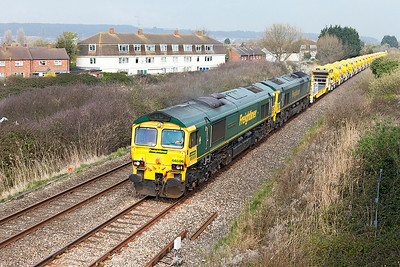 66506 'Crewe Regeneration' has 66525 DIT passing Oldmixon on the Weston-super-Mare avoiding line with 6C73 12.12 Westbury Yard to Fairwater Yard re-filled HOBC ballast wagons. Monday 27th March 2017.