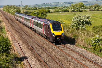 The 1V54 09.27 Newcastle to Plymouth formed of Voyager 220034 passes Middle Street, Brent Knoll. Sunday 7th May 2017.