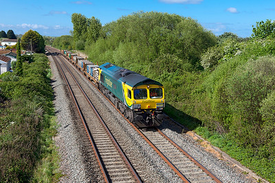 66528 'Madge Elliot M.B.E' heads along the Weston-super-Mare avoiding line at Hutton Moor with 4E18 09.47 Fairwater Yard to Doncaster Wood Yard reclaimed sleepers from the TRT. Wednesday 26th April 2017.
