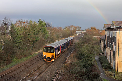 With a rainbow forming in the background 150130 departs from Worle forming 2C77 13.00 Cardiff Central to Exeter St. Davids. Tuesday 7th February 2017.