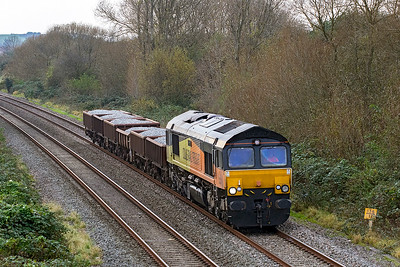 66849 'Wylam Dilly' passes Hutton Moor on the Weston-super-Mare avoiding line heading 6Z66 10.52 Tavistock Junction to Bristol Temple Meads consisting of six loaded ballast  wagons. Wednesday 1st November 2017.
