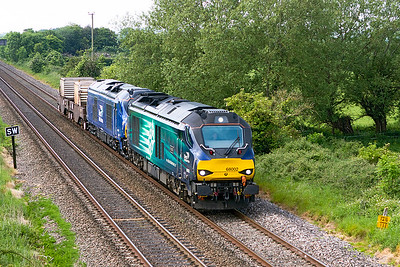 68002 'Intrepid' & 68027 in the plain DRS livery pass Claverham with 6M63 11.58 Bridgwater to Crewe Coal Sidings with two FNA's. Wednesday 24th May 2017.