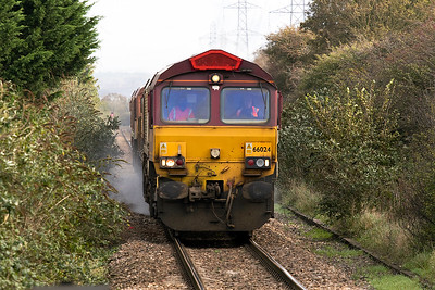 66024 leads the Barton Hill based RHTT approaching Weston Milton on the single line Weston-super-Mare loop. 66024 has gained a Margam Depot sheep badge between the cab windows and the wrong coloured horn grill. Friday 20th October 2017.