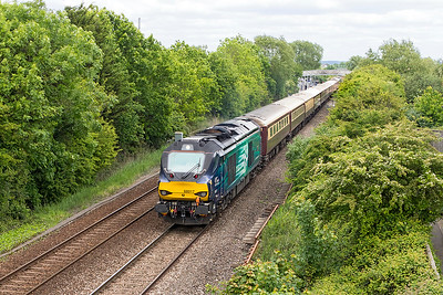 "68017 'Hornet' heads the ""Northern Belle"" past Worle Parkway running as 1Z68 12.35 Swindon to Swindon via Plymouth. 68002 'Intrepid' is DOR. Sunday 21st May 2017."
