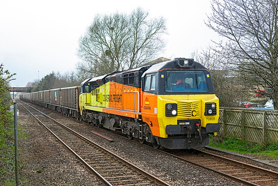 70805 passes Worle Parkway in the rain with 6C28 13.45 Exeter Riverside Yard to Westbury Down Yard empty stone wagons. Diverted via Bristol due to the derailment at East Somerset Junction. Tuesday 21st March 2017.